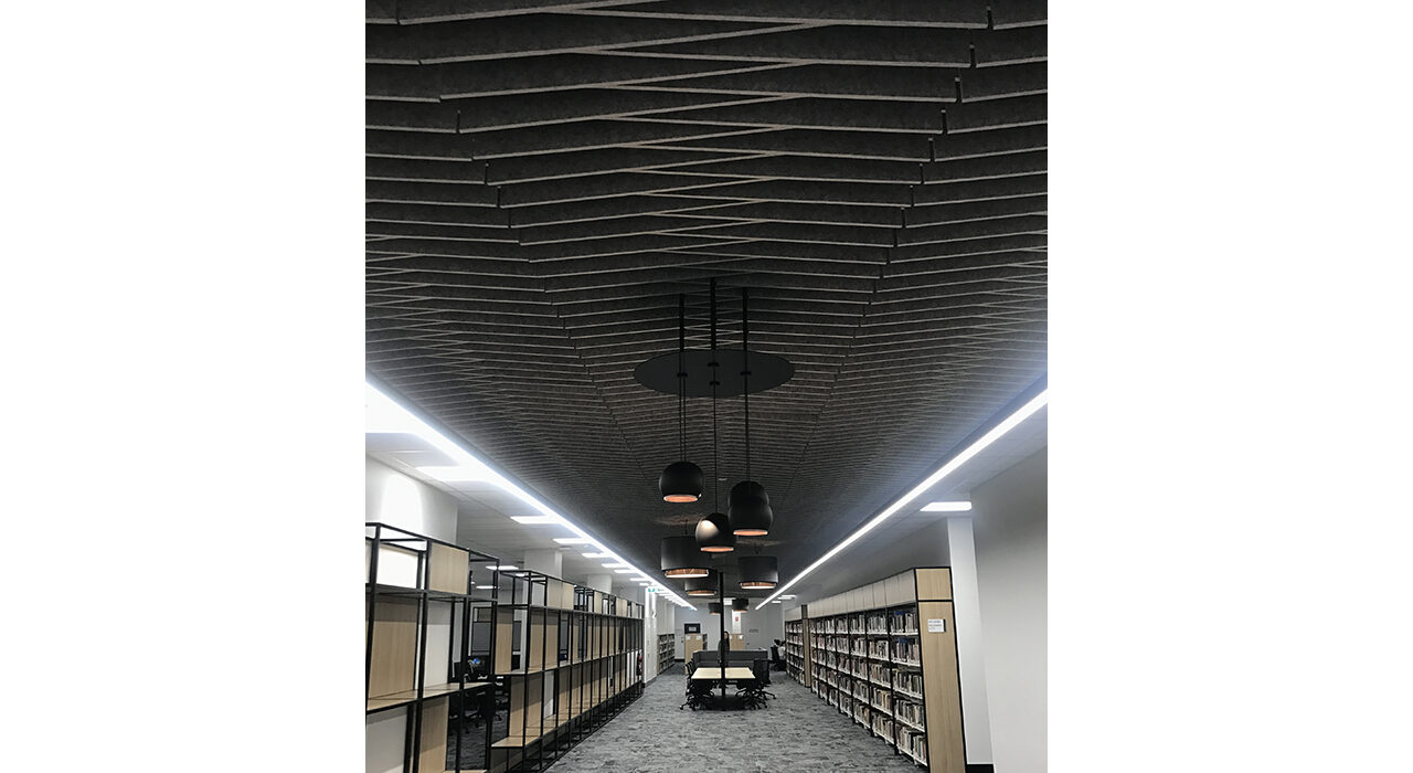 dark colored sound absorbing ceiling tiles in library