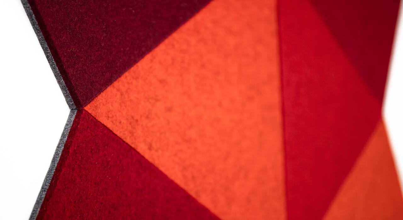 cut felt shaped acoustic tiles in red orange and maroon grouped together detail