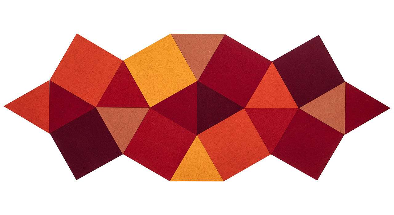 cut felt shaped acoustic tiles in red orange yellow and maroon grouped together
