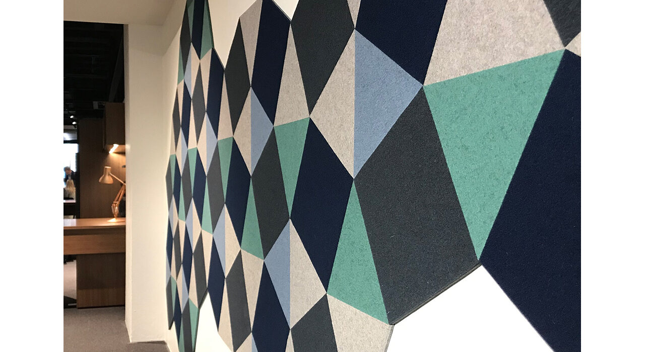colorful self sticking acoustic tiles arranged on wall at dramatic angle