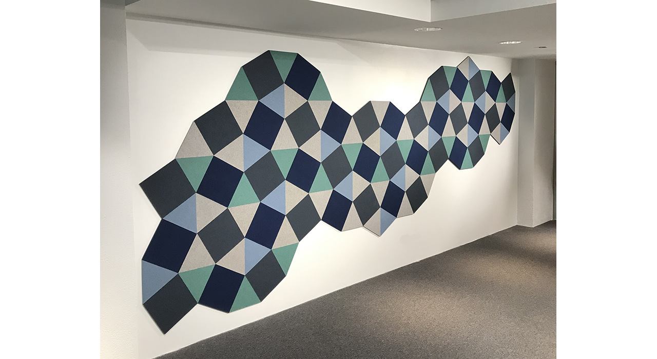 acoustic tiles made of felt cut into shapes acoustic tiles installed on wall in blue and green