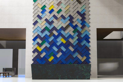 ecoustic edge sound absorbing acoustic wall tiles on wall in tan green yellow and blue