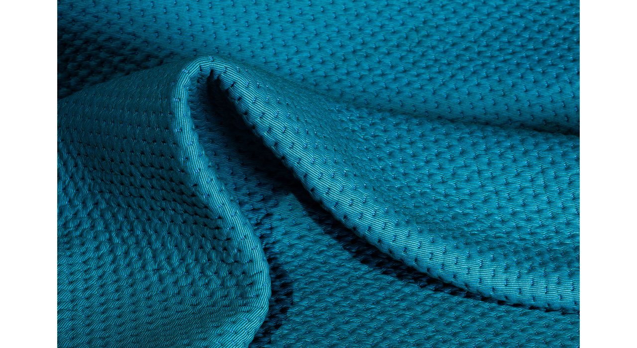 aqua blue upholstery textile with strong light and dark hero