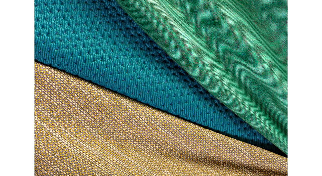 tan blue and green upholstery textiles folded