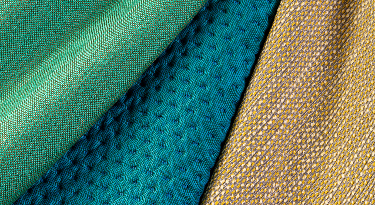 green blue and tan textured textiles