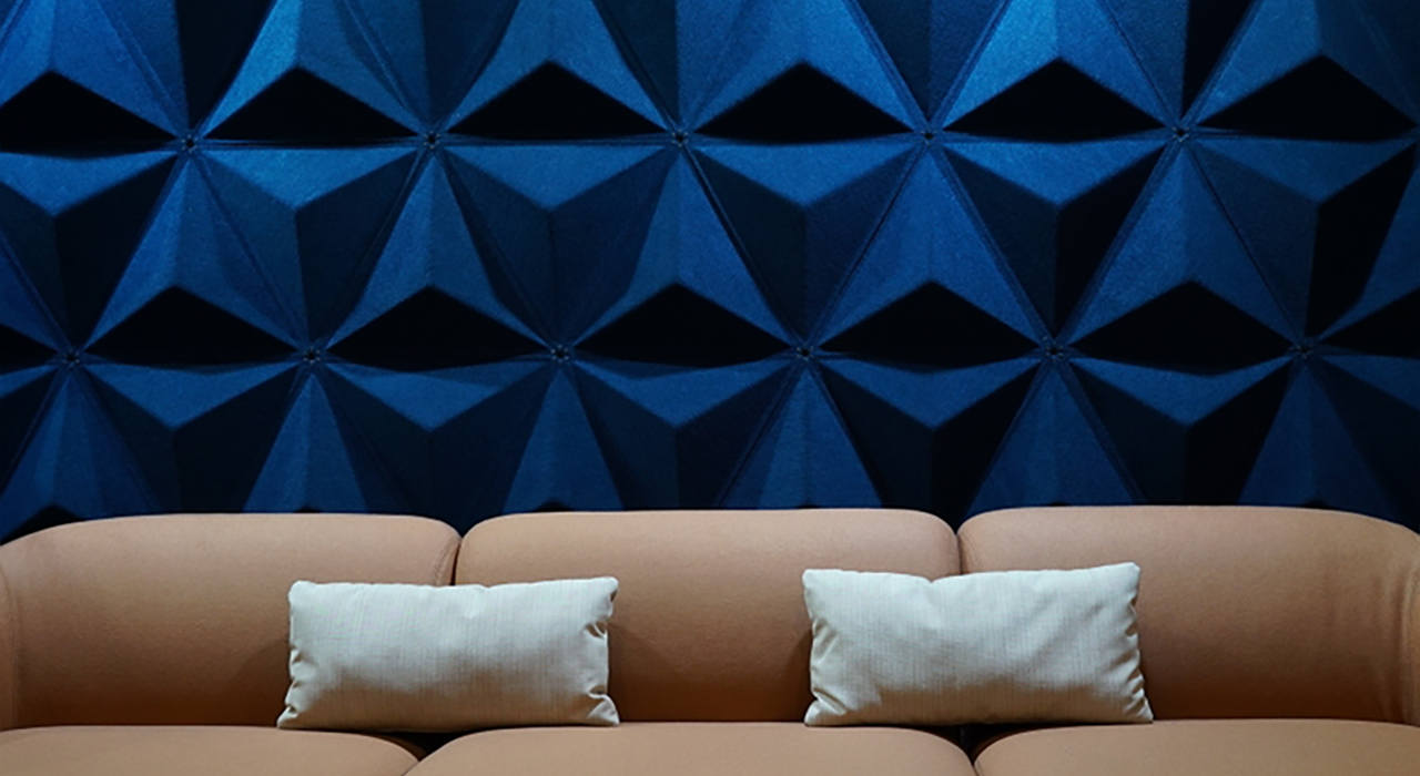 dark blue acoustic aircone tiles behind couch