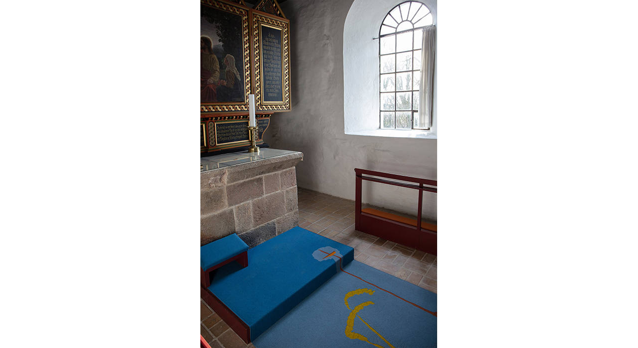 blue felt rug at church alter with large window