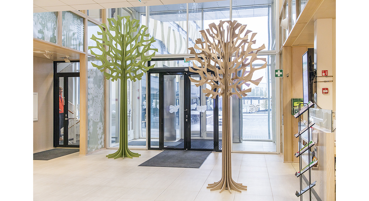 green and orange acoustic trees in entry way of store