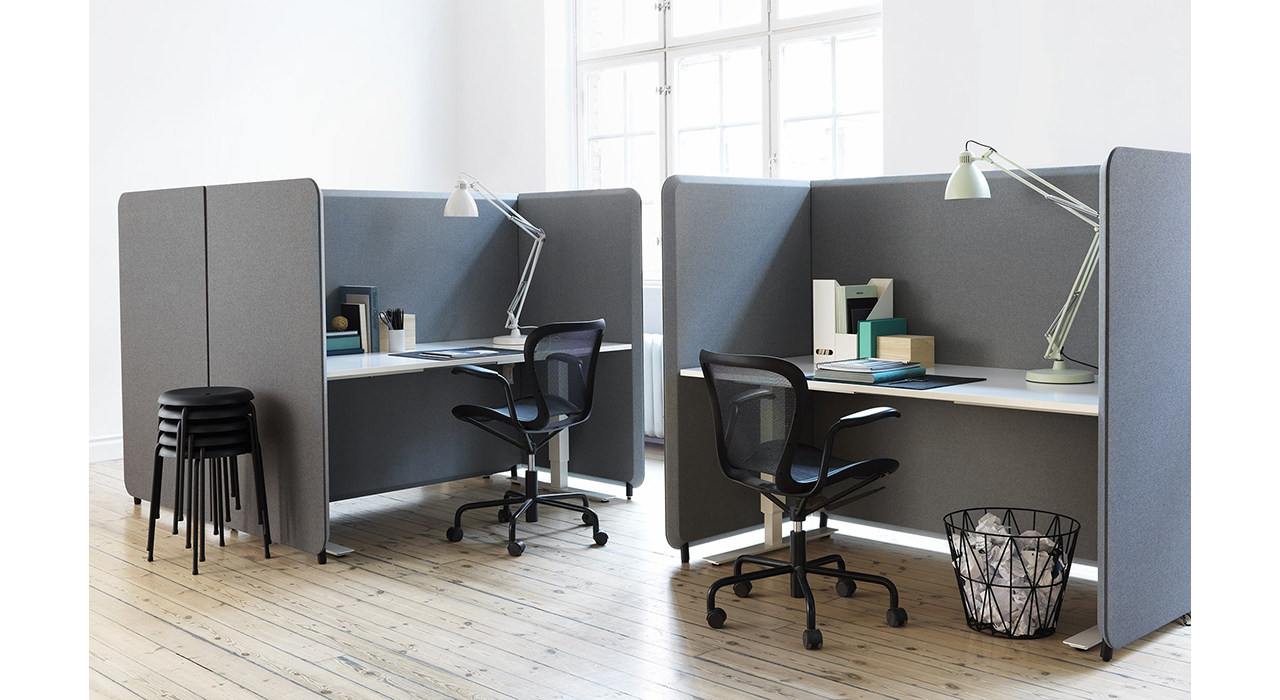 two desks with grey floor screens as cubicles