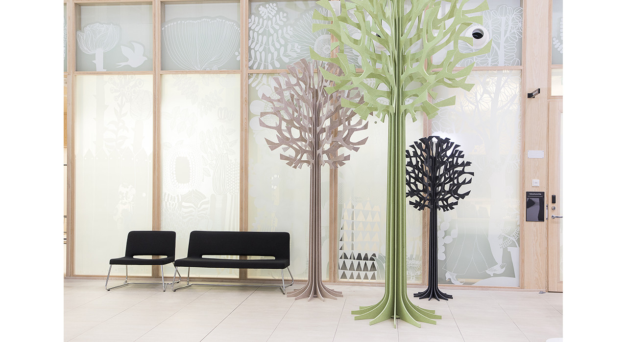 three acoustic trees in room with benches