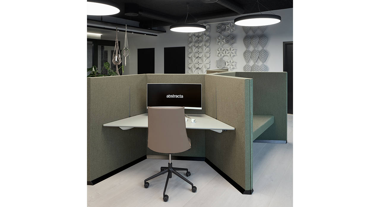 acoustic workstation with table monitor and chair in office