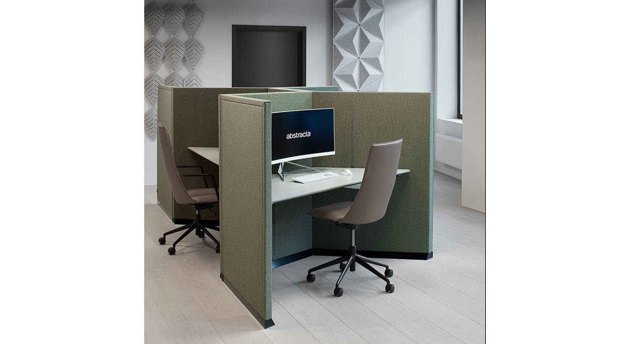green acoustic workstation with table chair monitor in office