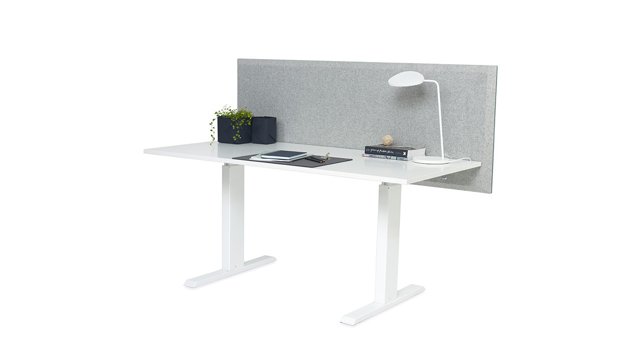grey acoustic table screen straight edges on desk with lamp and books