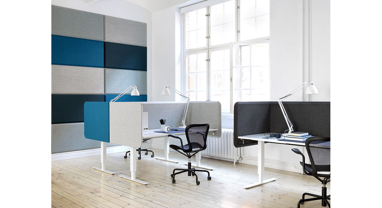 sound absorbing table partitions in office by large window