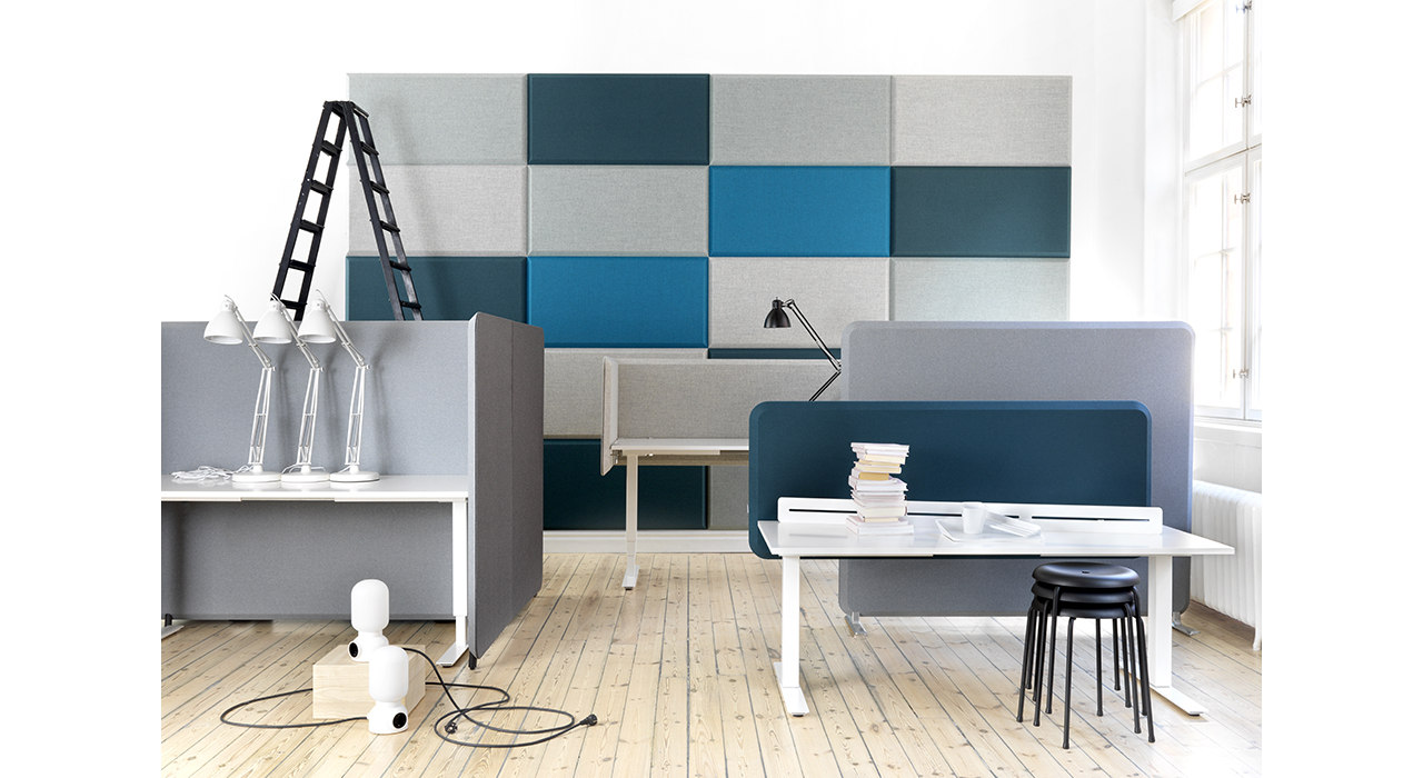 acoustic table screens in office with sound absorbing wall tiles and ladder behind