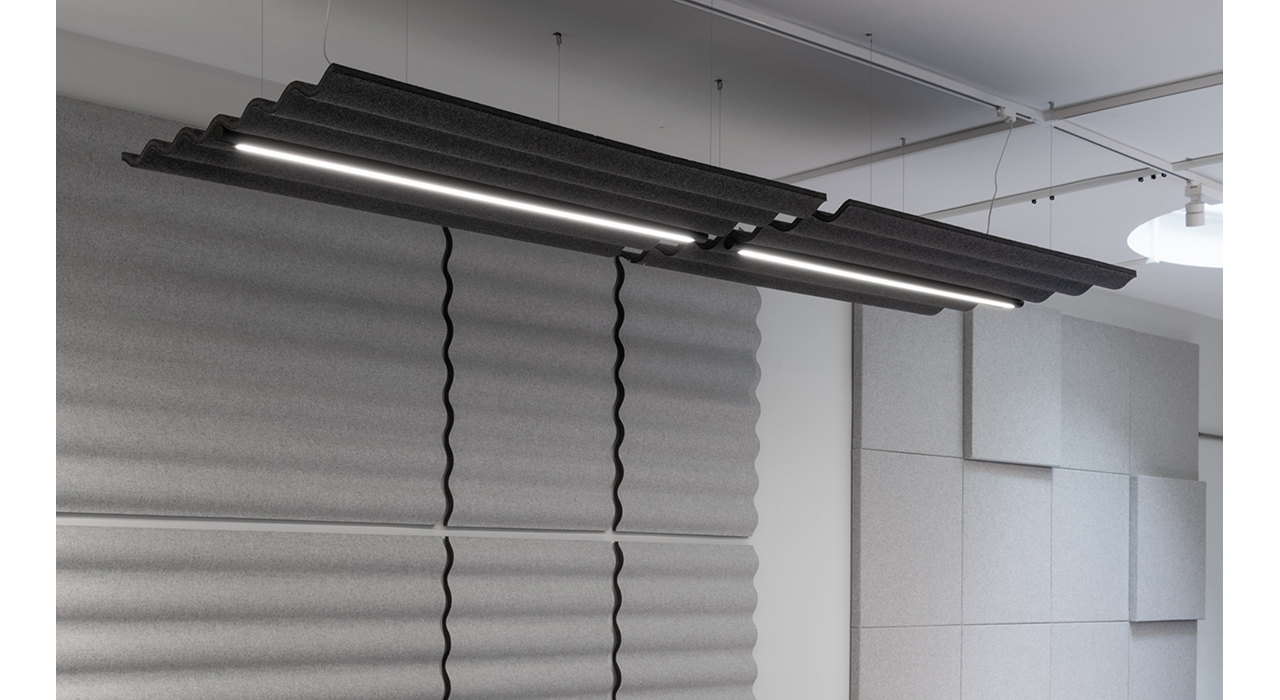 charcoal corrugated ceiling tile with lights suspended by wires