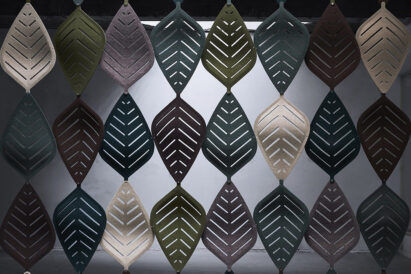 multi colored acoustic leaf tiles in formation as hanging partition