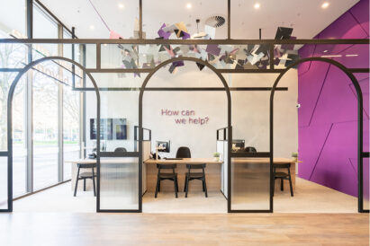 ecoustic-float-installation-on-ceiling-at-bank-purple-wall-glass-entry-hanging-over-seating-desk-area