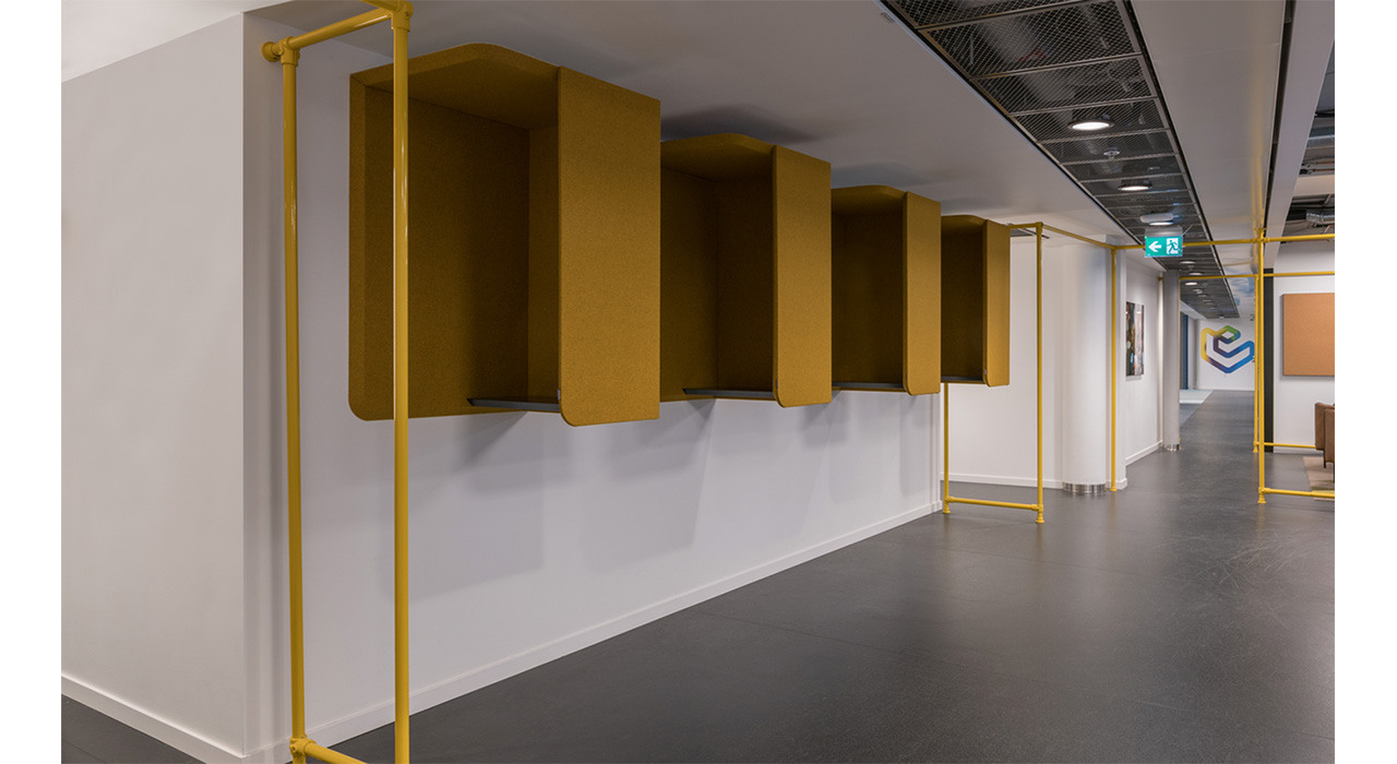 four yellow wall booths in hallway of office