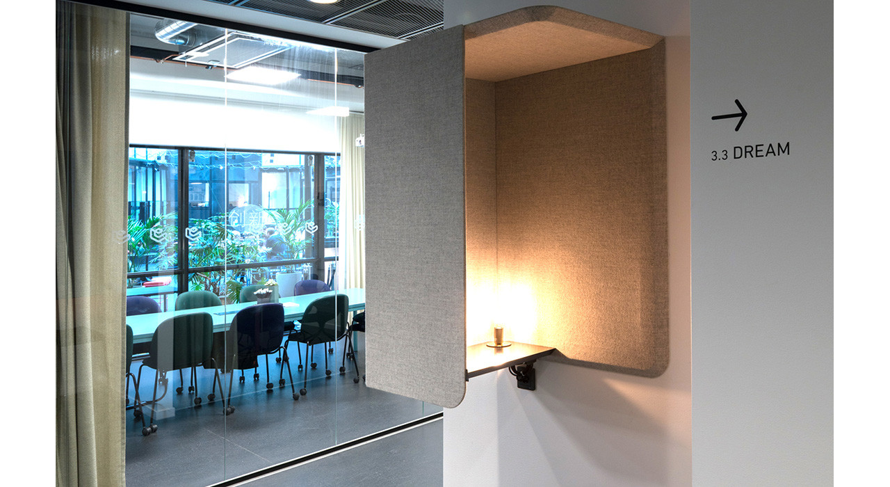 beige colored wall booth with light in a reception area