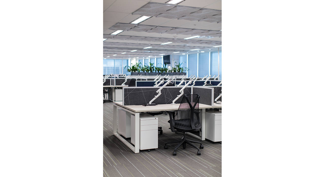 white ceiling tiles in office with desks and chairs vertical
