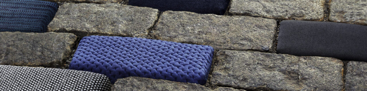 cobblestone street with fabrics over stones