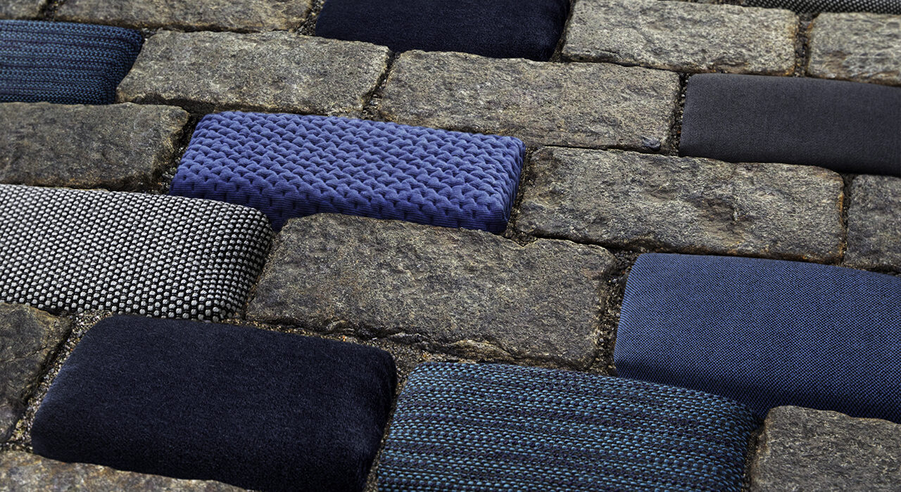 detail of blue textiles wrapped on stones on street