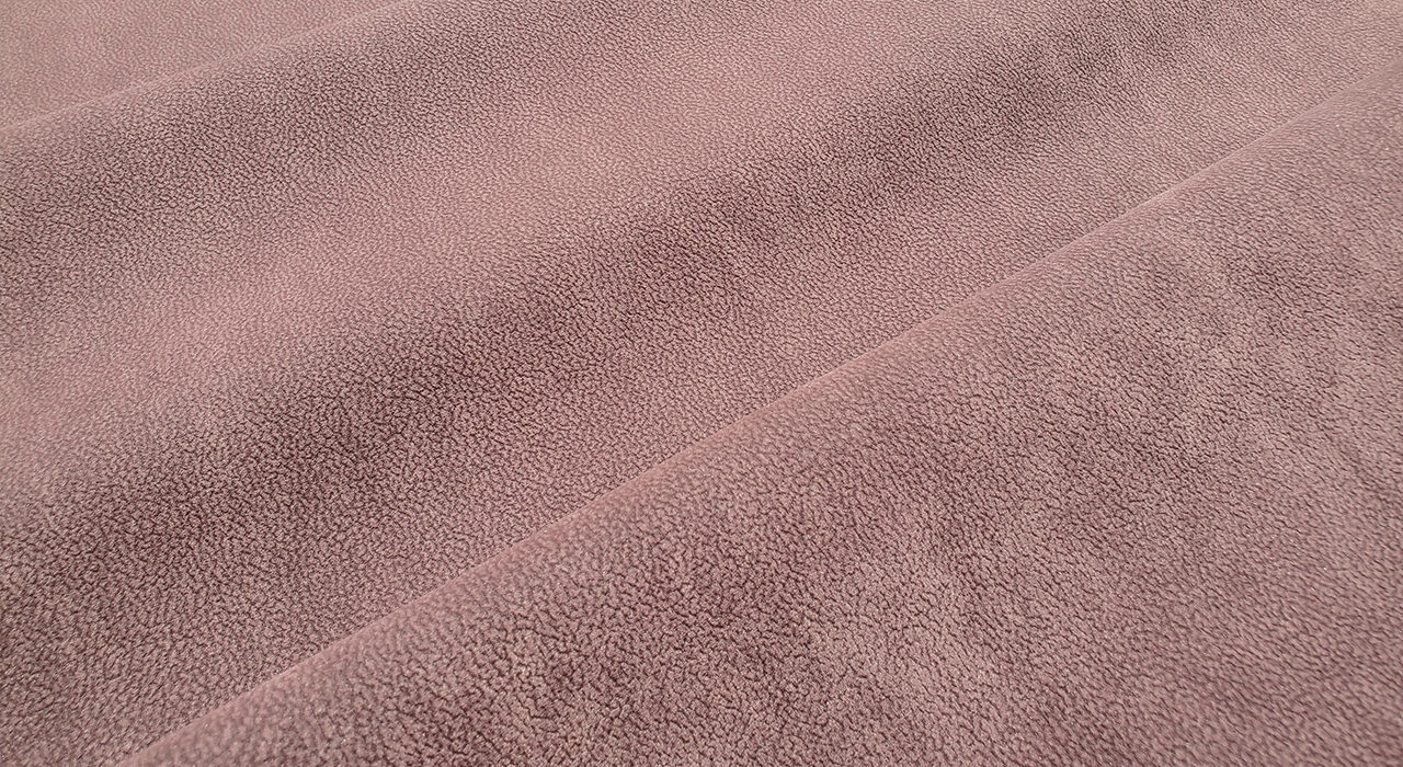 brown suede upholstery textile folded on itself smooth texture