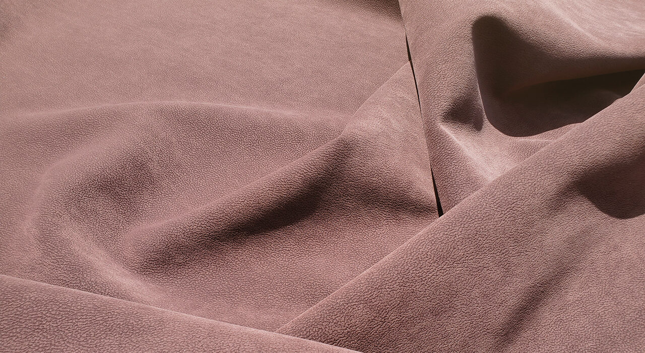 brown suede upholstery fabric bunched up showing shadows