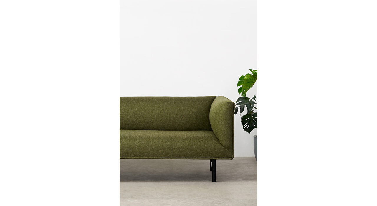 esprit textile on sofa with plant