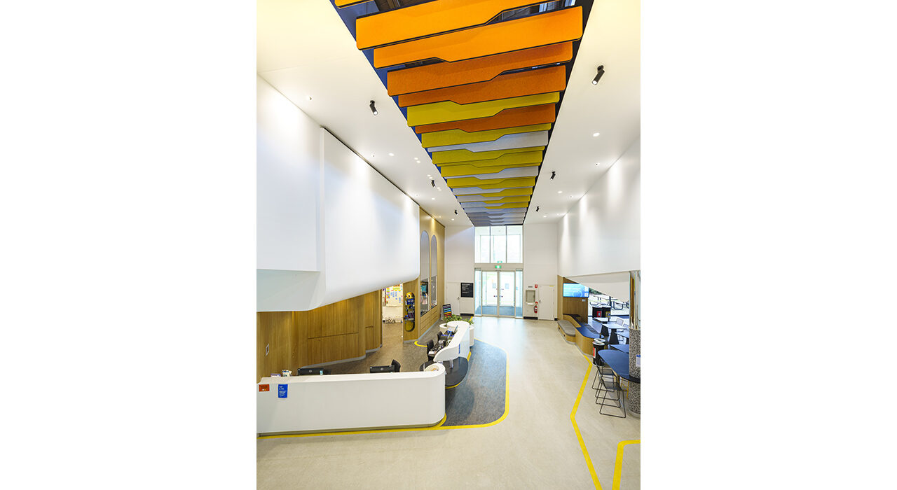 orange yellow and white baffles above office reception area