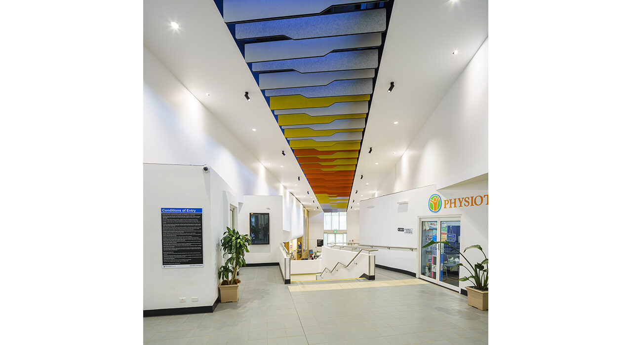 blue yellow and orange baffles above reception area