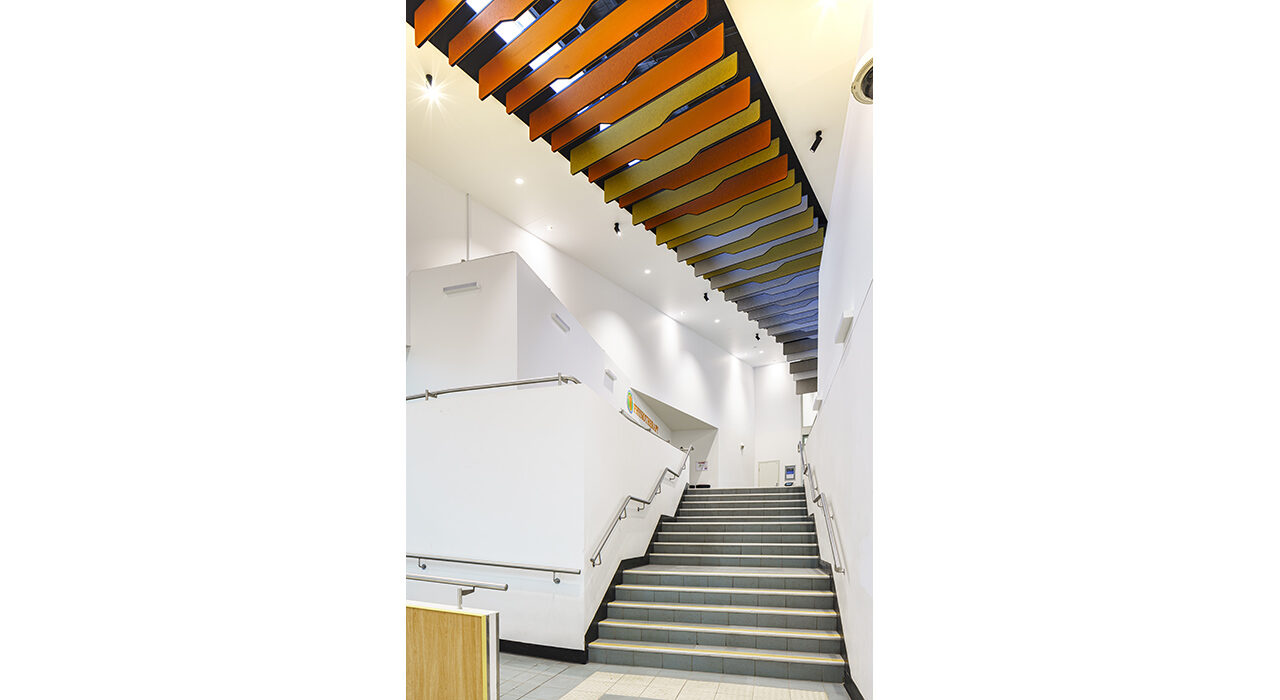 blue yellow and orange baffles above stairwell