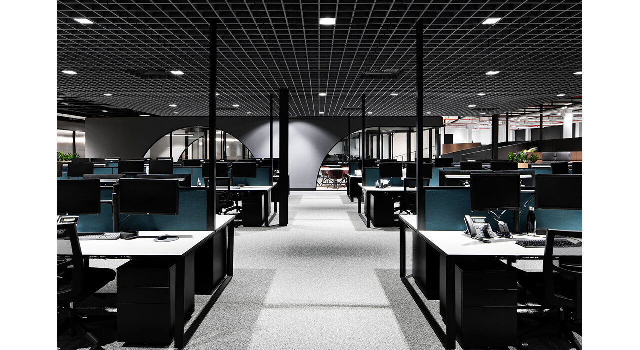sound-absorbing ceiling tiles above open office