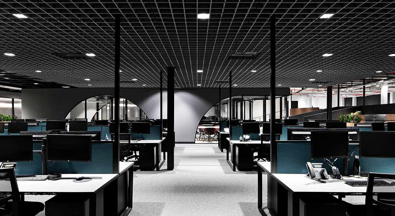 sound-absorbing drop ceiling tiles above open office