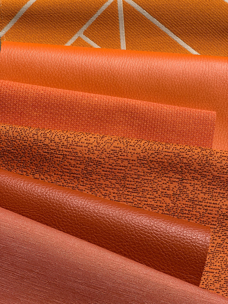 assorted orange textiles folded over for display