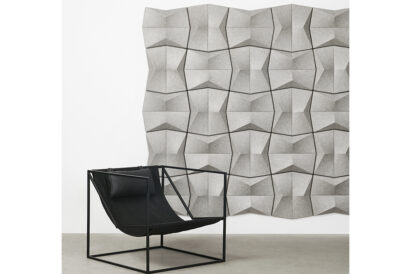 grey acoustic pinch wall tile with chair in front