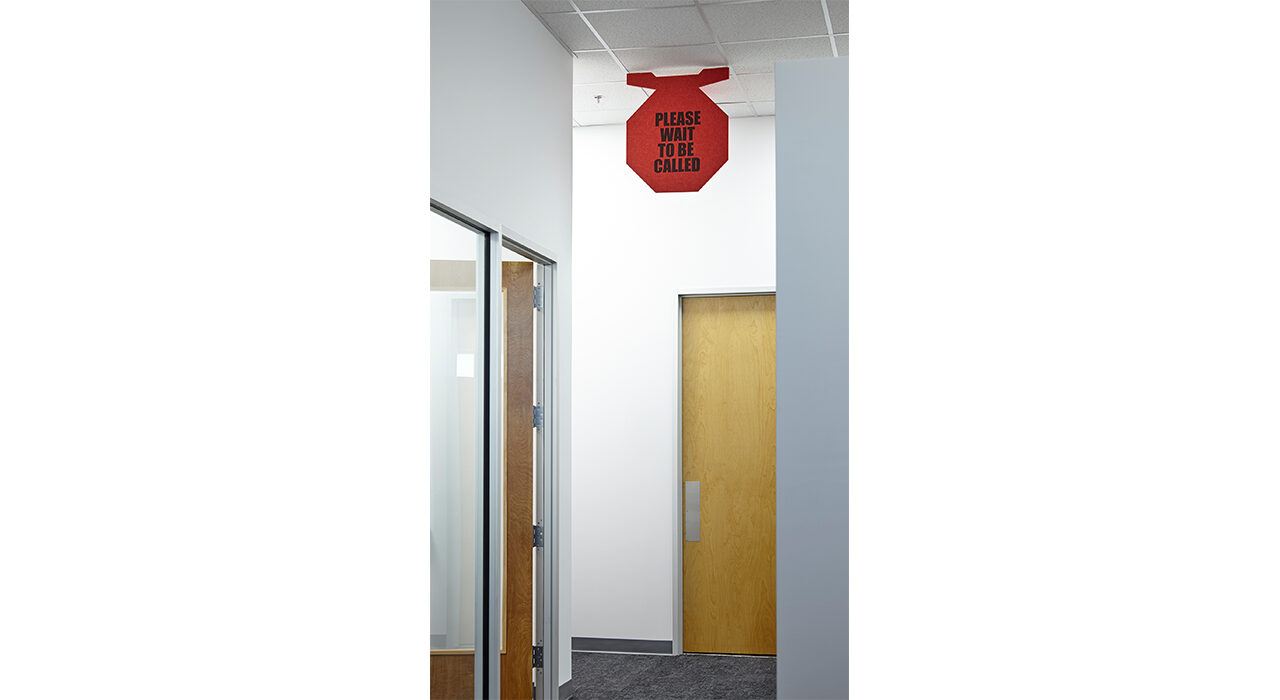 red wait to be called sign in office hallway