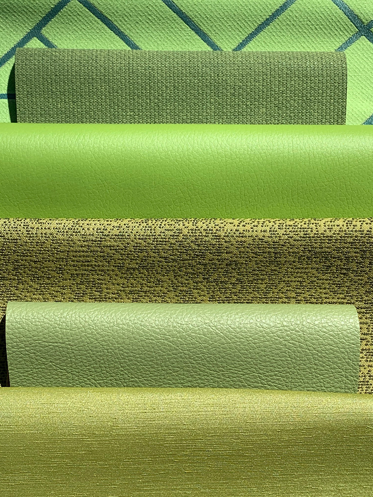 lime green textiles folded over laid on top of each other