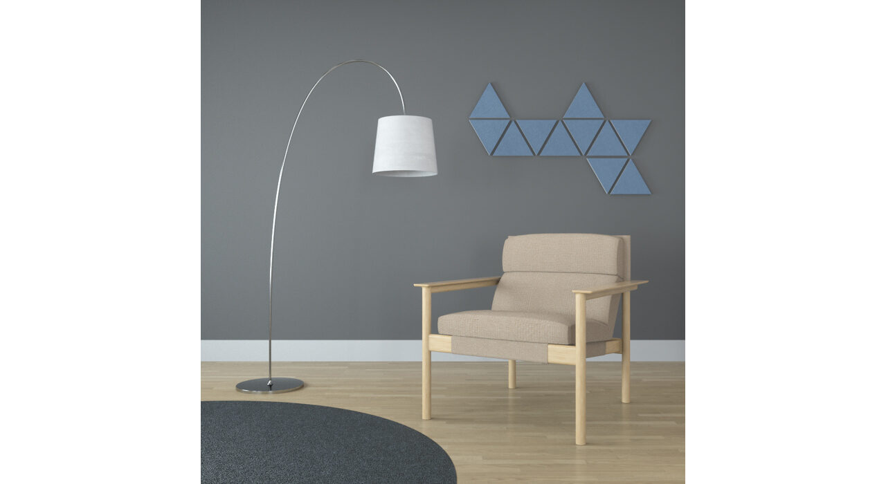 light blue triangle shaped sound absorbing self stick tiles on wall behind chair