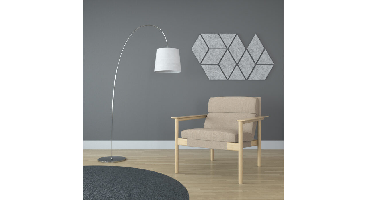 light grey diamond shaped sound absorbing self stick tiles on wall behind chair