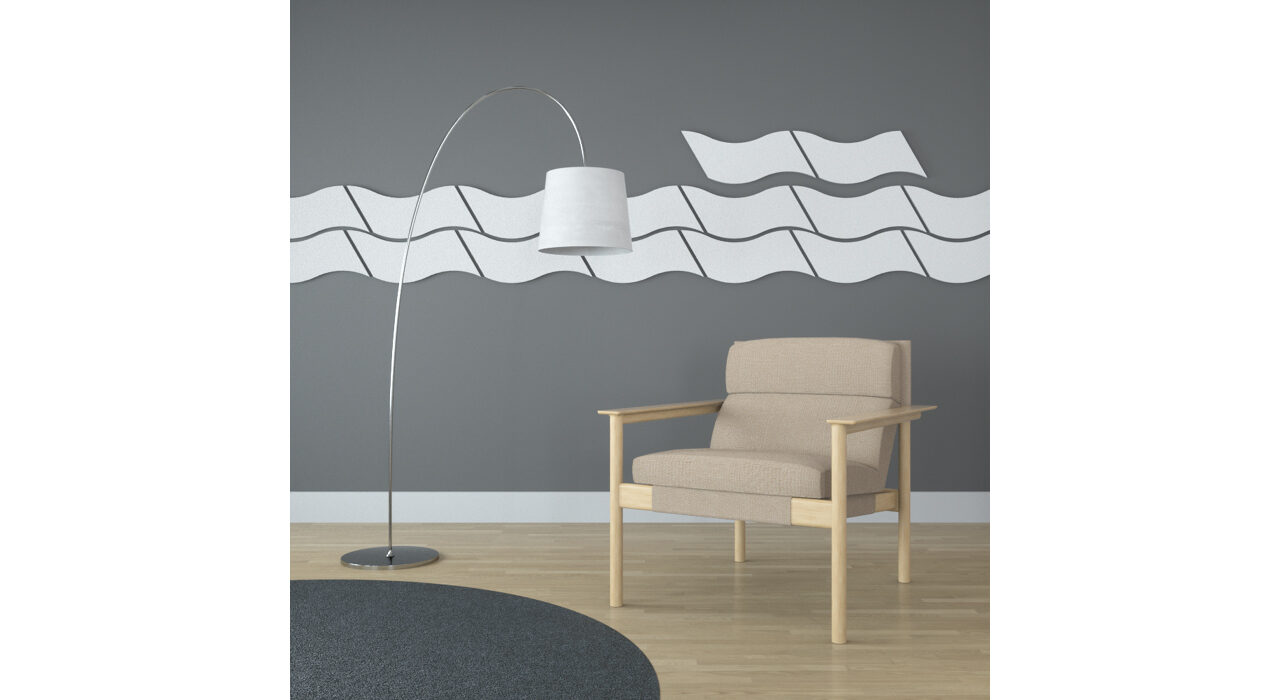 wavy white sound absorbing self stick tiles on wall behind chair