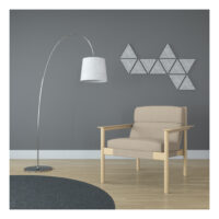 light grey sound-absorbing self-stick tiles on wall behind chair