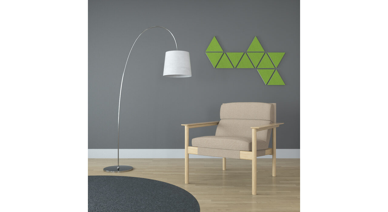 green triangle shaped sound absorbing self stick tiles on wall behind chair