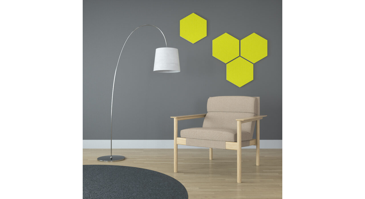 yellow hexagon shaped sound absorbing self stick tiles on wall behind chair