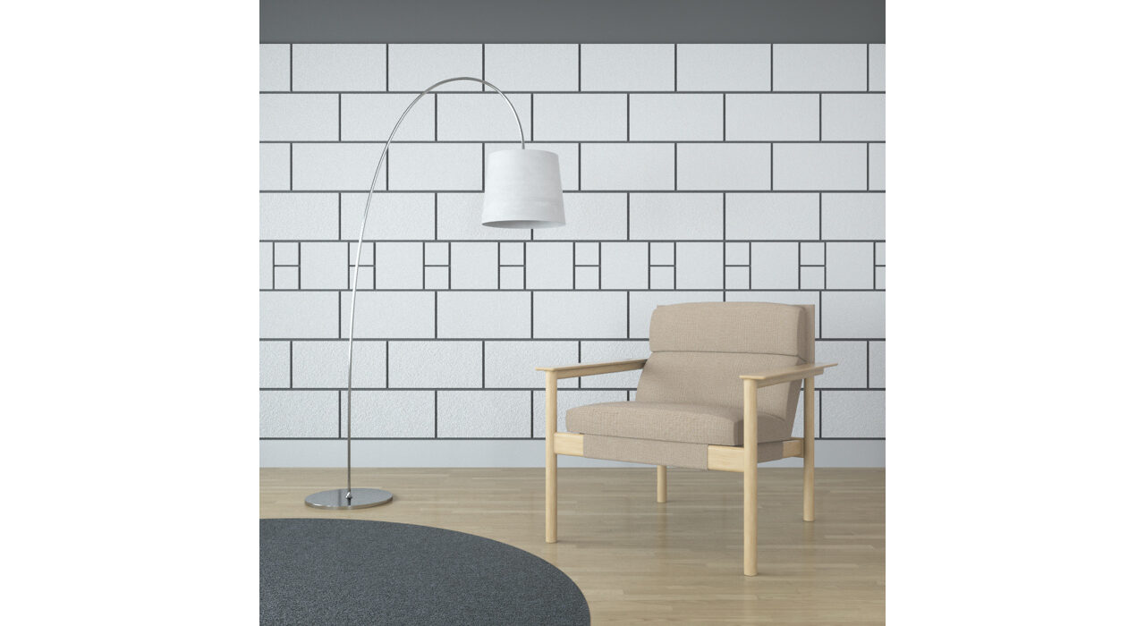 white multi-sized rectangular shaped sound absorbing self stick tiles on wall behind chair