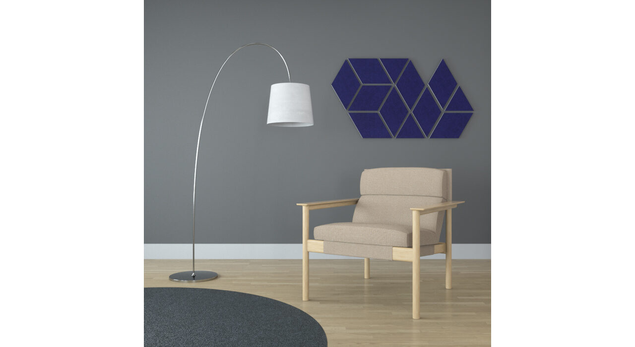 blue diamond shaped sound absorbing self stick tiles on wall behind chair