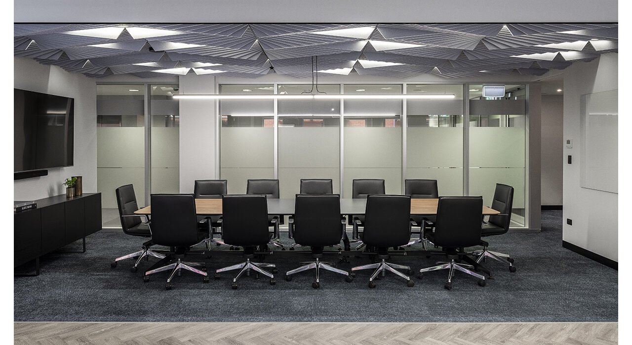 light grey sound-absorbing ceiling tile above conference room table